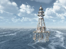 Lighthouse in the stormy ocean Stock Images
