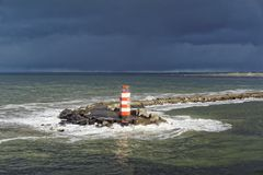 Lighthouse in Stormy Sea Stock Photo