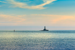 Lighthouse in stormy sea Royalty Free Stock Image