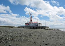 Lighthouse Straits of Magellan with shore, clouds, Punta Delgada, Chile Stock Images