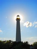 Lighthouse and sun Stock Image