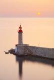 Lighthouse and sun Stock Photo