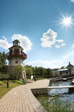 Lighthouse and sun stock photography