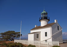 Lighthouse on Sunny Day. Old Point Loma lighthouse is a small white lighthouse on a sunny day at Cabrillo National Monument in San Diego, California Stock Photography