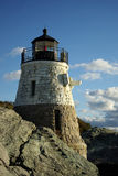 Lighthouse on Sunny Day. A picturesque view of small white Castle Hill lighthouse on a bright sunny day in Newport, Rhode Island stock photography