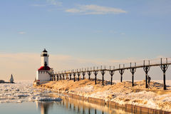 Lighthouse on Sunny Winter Day with Man Running stock photo