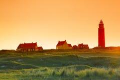 Lighthouse sunrise. Lighthouse at sunrise on dutch island Texel Royalty Free Stock Photography