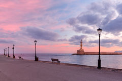 Lighthouse at sunrise, Chania, Crete, Greece. Lighthouse in old harbour of Chania at sunrise, Crete, Greece Royalty Free Stock Image
