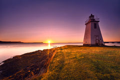 Lighthouse during sunrise in the early morning Stock Photos
