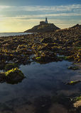 Lighthouse sunrise. Mumbles lighthouse on a brisk winters morning Stock Photography