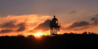 Lighthouse in sunrise over the sea - Rotterdam port, Netherlands stock image