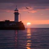 Lighthouse on sunrise. Yalta, Crimea, Ukraine Royalty Free Stock Photo