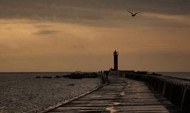 Lighthouse at sunset. Lighthouse in beautiful sunset lighton in the Baltic Sea Stock Images