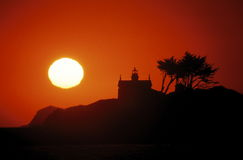 Lighthouse at sunset. A view of the lighthouse at Crescent City, California at sunset Stock Photos