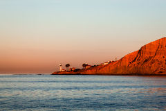 Lighthouse at Sunset. New Point Loma lighthouse in Point Loma San Diego, California at sunset with a clear sky and red lanscape Royalty Free Stock Image