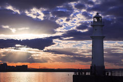 Lighthouse at sunset Stock Photos