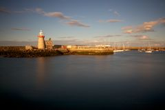 Lighthouse at Sunset. The lighthouse of Howth, at the north of Dublin Bay, Ireland, before sunset Stock Photos
