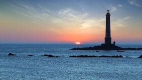 Lighthouse during sunset.. Landscape with Lighthouse during sunset. Brittany, France stock photo