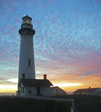 Lighthouse in the Sunset. Pigeon Point lighthouse set against a colorful sunset royalty free stock images
