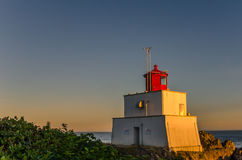 Lighthouse at Sunset. Amphitrite Point Lighthouse at Sunset, British Columbia, Canada stock image