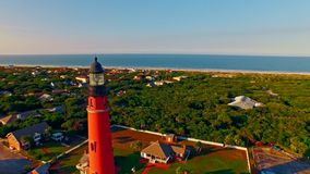 Lighthouse at sunset by Atlantic ocean stock footage