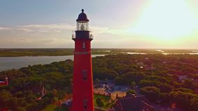 Lighthouse at sunset by Atlantic ocean stock video