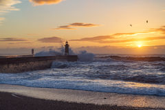 Lighthouse at sunset by the Atlantic ocean in Oporto, Portugal royalty free stock image