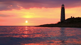 Lighthouse at sunset stock video