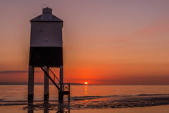 Lighthouse in sunset. Lighthouse from Burnham on Sea is the guard of bay for the fishing boats Stock Image
