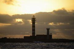 Lighthouse and sunset Royalty Free Stock Photos