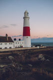 Lighthouse at sunset on coast of Portland, Dorset, England. Lovely summer scene in Dorset England royalty free stock photo