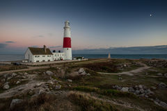Lighthouse at sunset on coast of Portland, Dorset, England. Lovely summer scene in Dorset, England stock photos