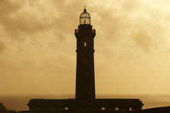 Lighthouse at sunset in Faial island. Ponta dos Capelinhos. Azor Stock Photography