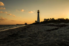 Lighthouse on sunset at the Florida State Park, Key Biscayne. A couple walking in the beach of the Lighthouse on sunset at the Florida State Park, Key Biscayne Royalty Free Stock Images