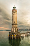 Lighthouse and sunset in harbor of Lindau in lake Constance Stock Photo