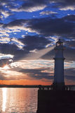 Lighthouse at sunset with light beam Royalty Free Stock Photo
