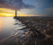 Lighthouse in the sunset light Stock Images