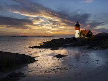 Lighthouse at sunset. Located off the coast of massachusetts, USA Stock Photos