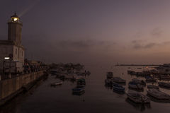 Lighthouse sunset in Manfredonia - Gargano.  Stock Photo