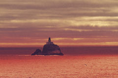 Lighthouse off Oregon coast at sunset Royalty Free Stock Image