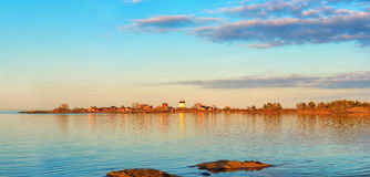 Lighthouse in sunset, Panorama. Svartklubben in Grisslehamn, Sweden Stock Photography