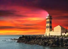 Lighthouse at sunset, purple seascape Stock Photo