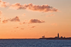 Lighthouse on the sunset Stock Photos