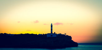 Lighthouse at sunset Stock Image