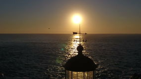 Lighthouse in the sunset stock footage
