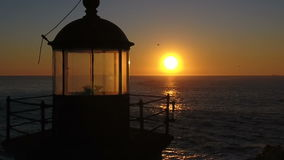Lighthouse in the sunset 02 stock footage