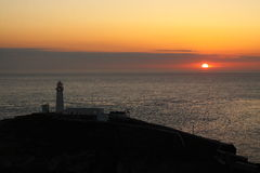 Lighthouse sunset summer solstice B Stock Image