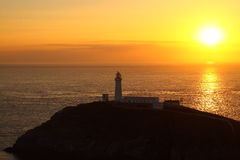 Lighthouse sunset summer solstice A Royalty Free Stock Photo