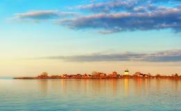 Lighthouse in sunset. Svartklubben in Grisslehamn, Sweden Stock Photography