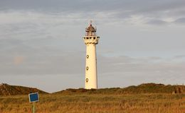 Lighthouse at sunset in the twilight. Egmond aan Zee, North Sea, the Netherlands. Royalty Free Stock Photography